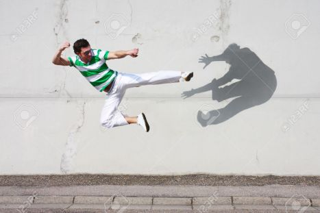 8175006-man-fighting-against-his-own-shadow-stock-photo-shadow-fight-taekwondo-1